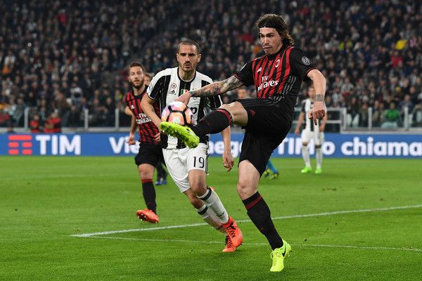 Alessio Romagnoli (L) of AC Milan in action against Leonardo Bonucci of Juventus FC during the Serie A match between Juventus FC and AC Milan at Juventus Stadium on March 10, 2017 in Turin, Italy.