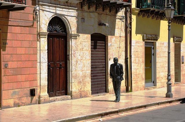 The famous sicilian author Leonardo Sciascia walking in his native town Racalmuto