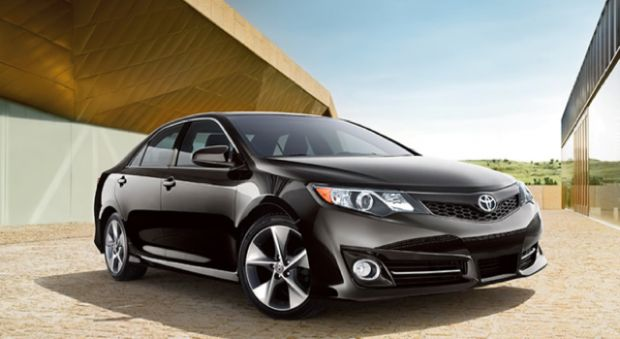I would have a black 2013 Toyota Camry SE with black leather and suede interior