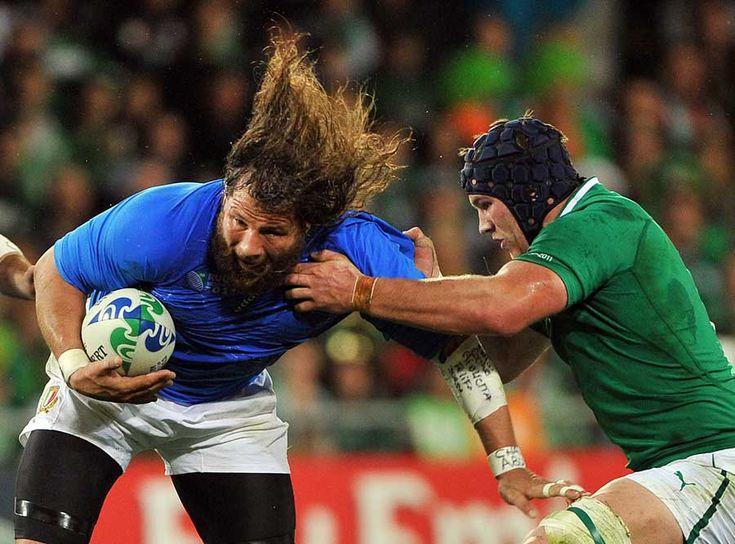 Italy's Martin Castrogiovanni looks to evade the grasp of Sean O'Brien, Ireland v Italy, Rugby World Cup, Otago Stadium, Dunedin, New Zealand, October 2, 2011
