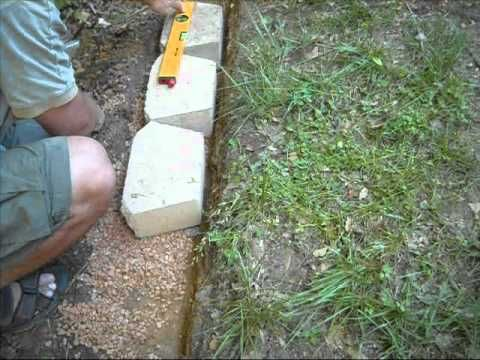 Building a Concrete Block Retention Wall - YouTube