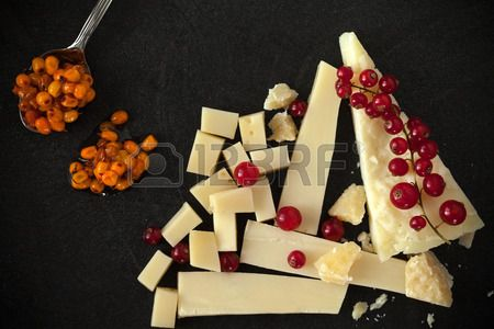 Cheese platter with redcurrant and sea buckthorn jam. Stock Photo