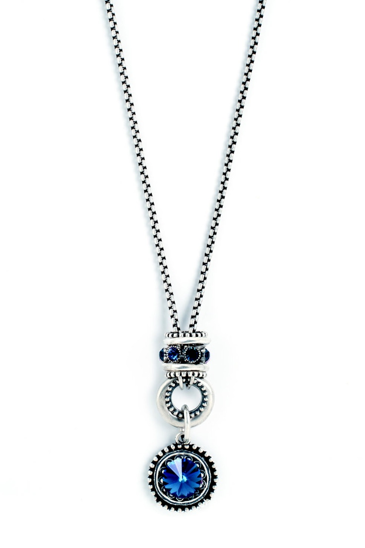 Our dark blue ornate enhancer is bold enough to carry and complement an equally impressive necklace - like this silver chain adorned with Montana Swarovski crystals and an intricately detailed pendant.