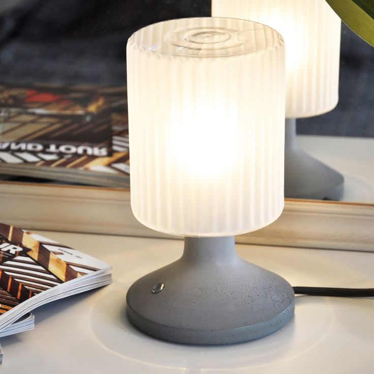 Isolde comes with a matt satined glass globe and you have the choice of four cord colours: a warm grey, a sunny yellow, designer red or blue. The base of every lamp is made of concrete which is handmade in Germany.