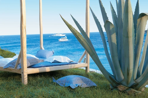 Mykonos Blu resort in Greece - Four-poster bed frames make great sun loungers.