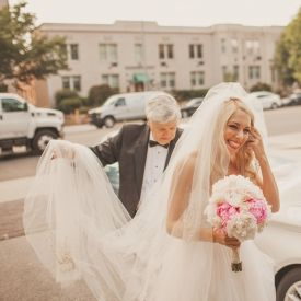 A beautiful bride arriving at the church with her dad - so sweet!