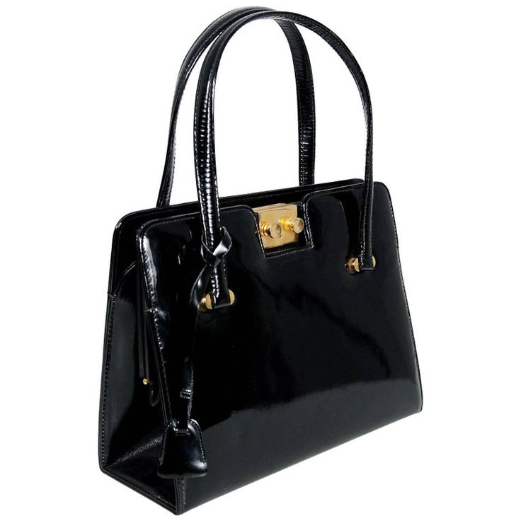 1960's Gucci Rare Black Patent Leather Lock and Key Structured Handbag Purse | From a collection of rare vintage top handle bags at https://www.1stdibs.com/fashion/handbags-purses-bags/top-handle-bags/