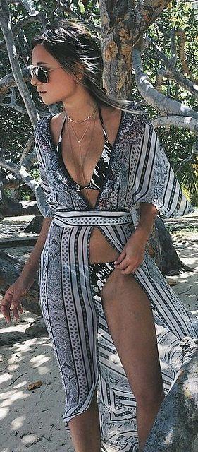 Danielle Bernstein wearing a body chain with her bikini on the beach.