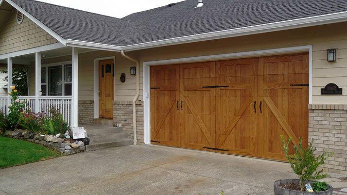 Garageskins give you a wood look without the cost wood for Wood veneer garage doors