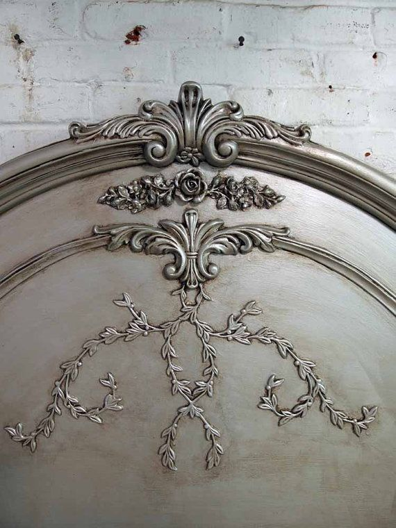 beautiful and ornate headboard.