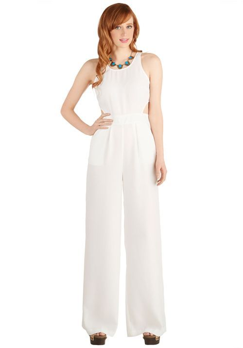 Keep your guests guessing with a stylish white jumpsuit for your rehearsal dinner!