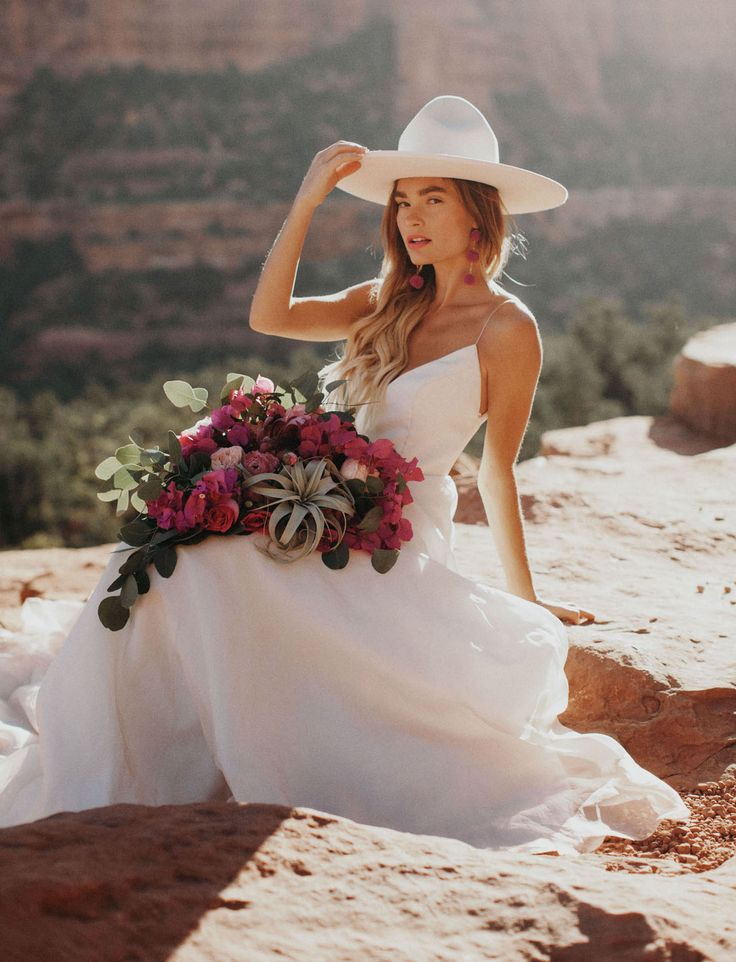 Bridal Trend with Hats -- look how perfect the pom pom earrings match the bouquet