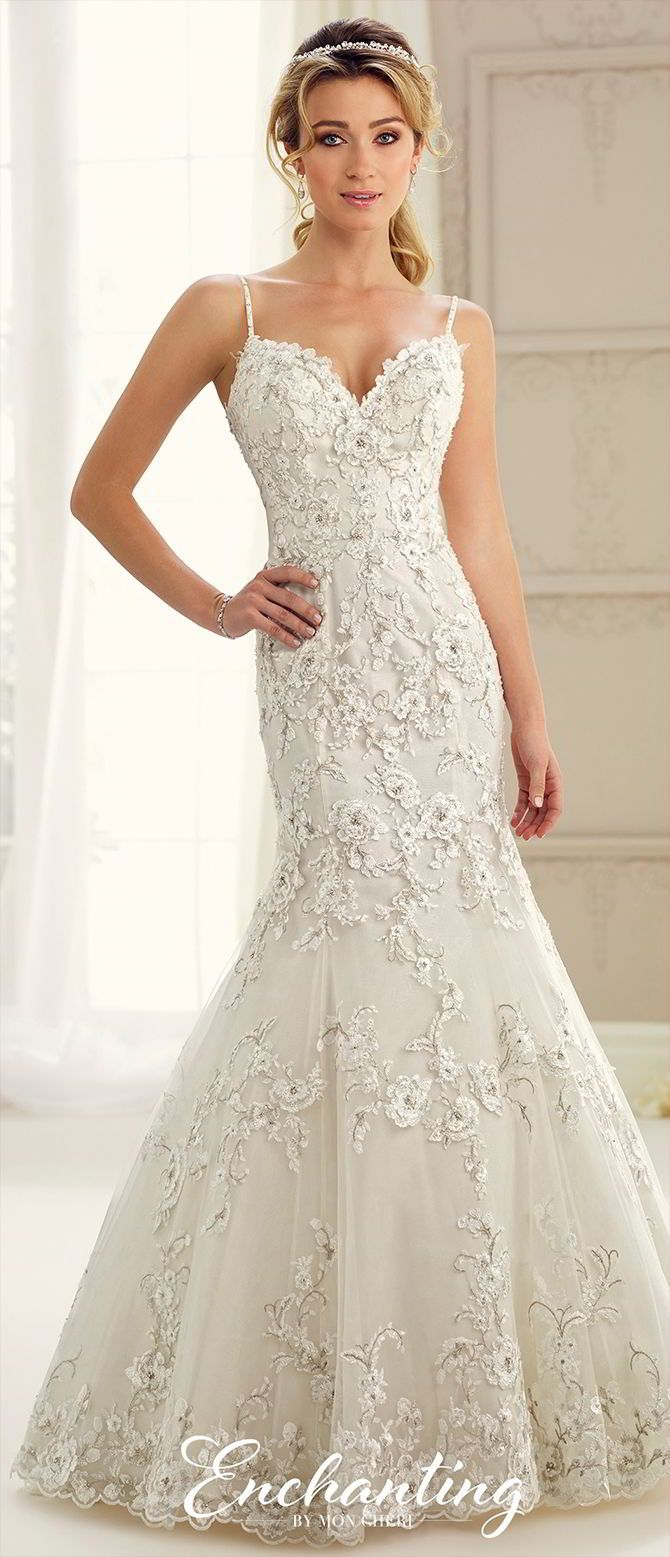 Sleeveless tulle, taffeta, organza, and lace trumpet gown with hand-beaded spaghetti straps, scalloped sweetheart neckline, hand-beaded lace bodice with dropped waist, V-back with covered buttons, scalloped hem, chapel length train.