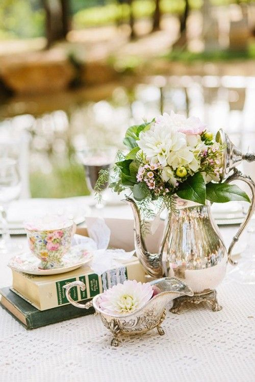 afternoon garden wedding, maybe even your bridal shower in a garden, using silver coffee pots as vases. books and tea cups giving  a very relaxed romantic feel