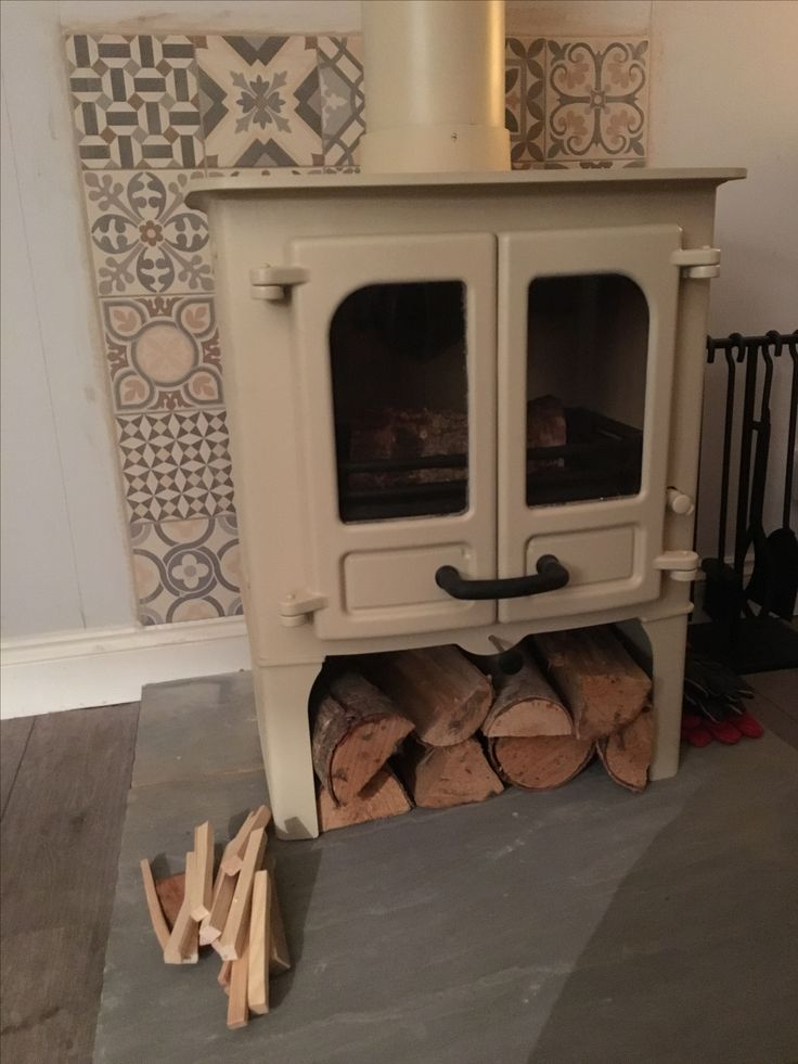 Cream log burner and heritage grey mixed tiles