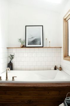 Wooden bathtub, white square tile, black frame, brass faucet