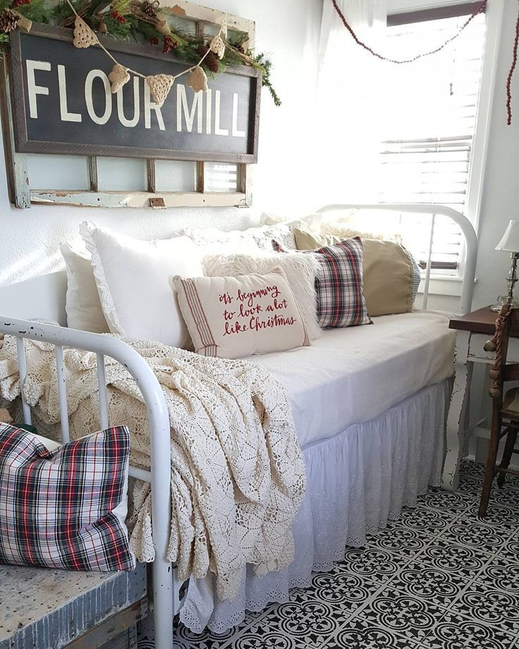Farmhouse daybed. Old window frame on the wall behind it with a flour mill sign. Looks awesome with the floor ~ it ties together so well!
