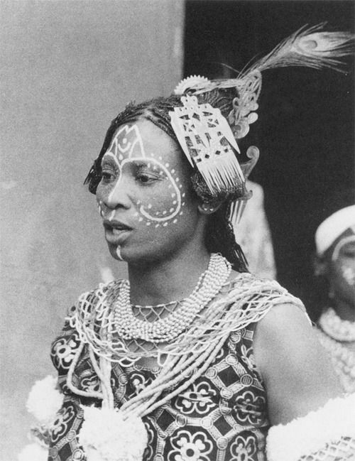 Ibibio Mami Wata priestess mary magdalena w. chalk markings on her face.