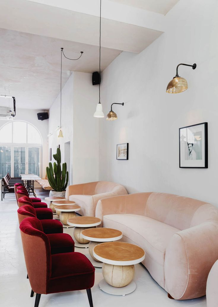 Ulitimate interior blush pink sofa, scandinavian design almost like a wes anderson film/ No. 197 Chiswick Fire Station restaurant interior design