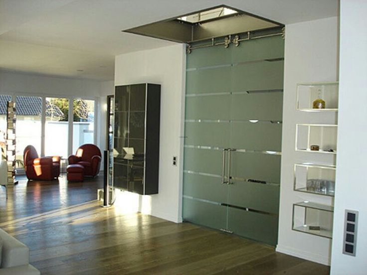 PIN 6: This glass door brings out a very shiny and glossy look. Its very modern and stylish. The simple designs present on the door shows a elegant and basic feel.