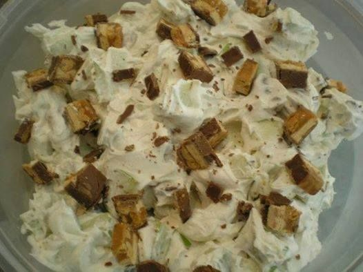 Snickers Salad  Ingredients 1 (8 ounce) packages cream cheese, softened 1 cup powdered sugar... 1 (12 ounce) containers Cool Whip, thawed 6 Snickers candy bars 4 -6 granny smith apples ( you can vary the apple with successful results if you choose to, but I would NOT recommend a soft va) Directions Mix cream cheese and powdered sugar until thoroughly blended. Fold in Cool Whip. Cut Snickers into bite size chunks and add to cream cheese mixture. Chop the apples into chunks and stir. Chill 1…