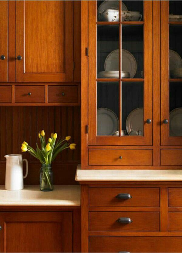 Wood cabinets, white counters