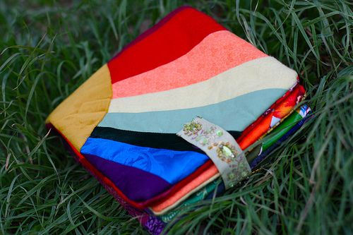 Make a book of different colors, and have different fabrics on each color page-- fleece, flannel, velvet, minky, silk, linen, etc. Teaches colors, and is also tactile.