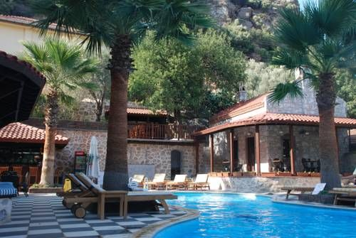 Dores Residence Turunc Offering accommodation with air conditioning, Dores Residence is situated in Turunc, 23 km from Marmaris. Rhodes Town is 36 km from the property. All units have a seating area. An oven and kettle are also offered.