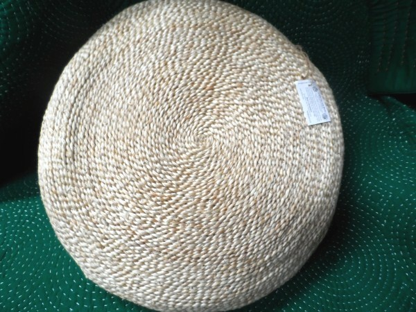 An elegant addition to any home decor is this handwoven jute cushion in a natural shade. A limited number of these    Measuring approx 53 cms in diameter and approx 12 cms high.    Please note as these are handmade cushions sizes may vary.  All materials used are natural and local to Bangladesh.    Handmade by a producer in Bangladesh. Corr the Jute Works