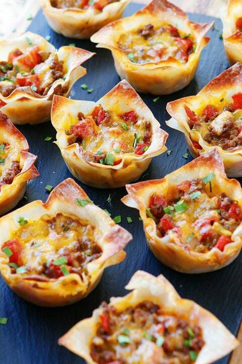 Crunchy Taco Cups 1 lb lean ground beef 1 envelope (3 tbsp) taco seasoning 1 can Ro-Tel Diced Tomatoes w/Green Chiles 1½ cups Mexican blend cheese 24 wonton wrappers Preheat oven to 375. Spray muffin tin with cooking spray. Mix beef, taco seasoning, & tomatoes. Line each cup of muffin tin with a wonton wrapper. Add 1.5 tablespoons taco mixture. Top with 1 tablespoon of cheese. Press down and add another layer of wonton wrapper, taco mixture, and a final layer of cheese. Bake @ 375 for 11-13…