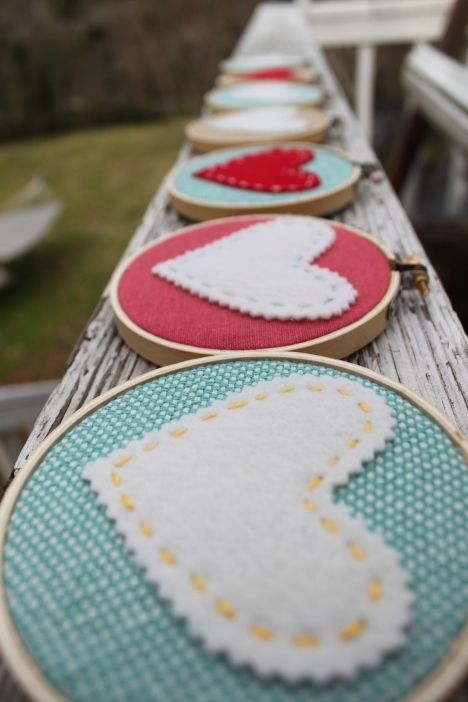 How about burlap in the hoops and felt hearts on top?  A little lace.... or use like a banner with the couple's name?  Do this with lace from wedding gown, date and initials stitched on top.