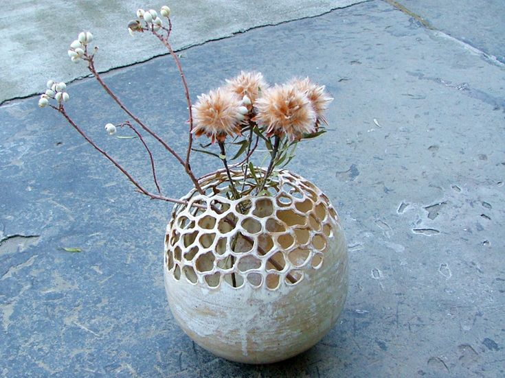 Ceramic art by Emogayu. A rather great idea for a vase in regards to easy flower arrangement