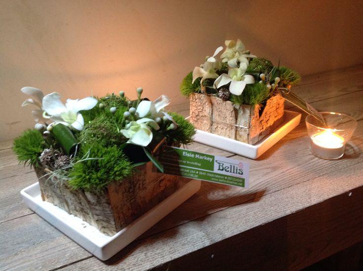 Tafelstukjes met witte Orchideeën.
