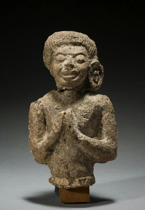 Worshipper Place of Origin: Central Thailand Date: approx. 600-800 Materials: Stucco Style or Ware: Dvaravati Dimensions: H. 7 1/4 in x W. 4 1/4 in x D. 1 3/4 in, H. 18.4 cm x W. 10.8 cm x D. 4.4 cm