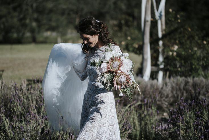 Emily Stockings in her Juliette Hogan Corvette Bridal Dress
