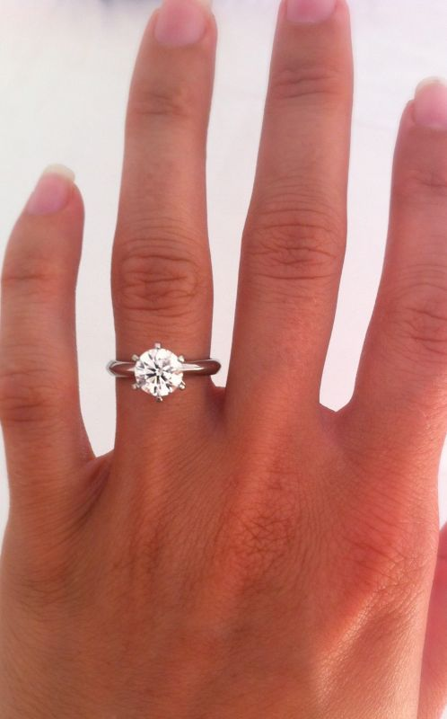 1.5 carat on size 5 finger. Justin, in the future when you're looking for my engagement ring, this is what i want, just a little smaller diamond.