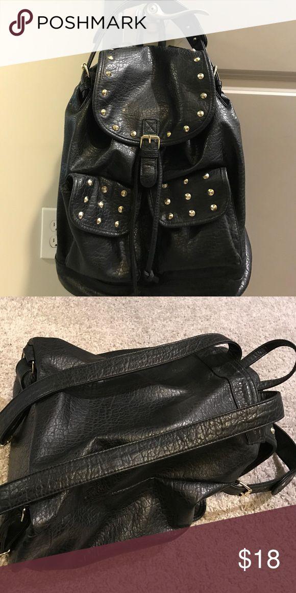 Studded backpack Black studded backpack. God hardware. Top handle is detachable. Bags Backpacks