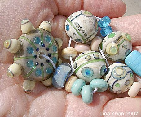 lina khan lampwork beads tinajo wheel ivory wheel and beads decorated with silver
