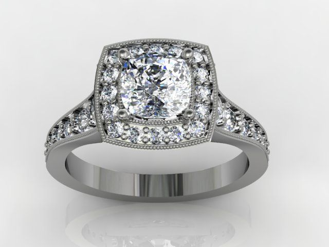 Great round center diamond set in a cushion halo with a tapering diamond shank makes for one Cushion HaloCustom Engagement RingsThe