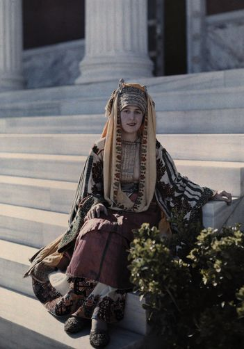 Portrait of woman dressed in costume of Astypalaea sitting on steps.MAYNARD OWEN WILLIAMS/National Geographic Creative