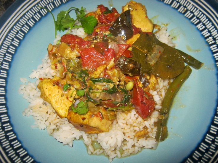 Cape Town Chicken tarkari with rice on a blue plate