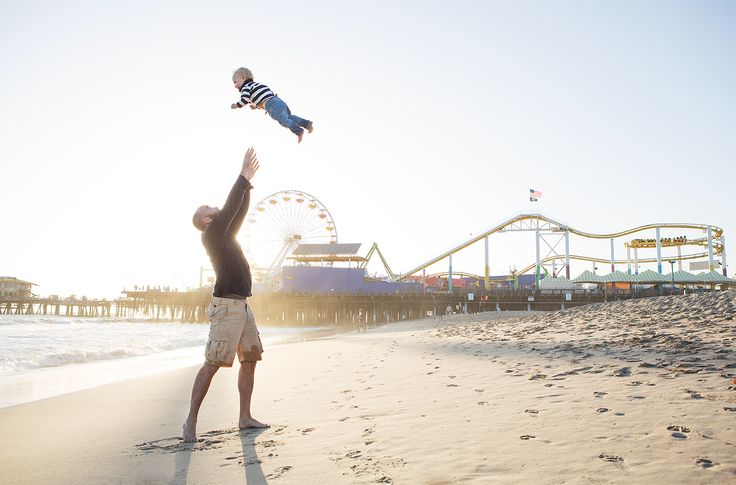 The funny part about this picture is that the first time Sam (the dad) threw Elliott in the air, he went out of the frame of the camera. I had to move back to accommodate the height of the toss. The kid was LOVING it!!!  #fatherhood #dad #fathers #throw #santamonica #fun #summer #sun