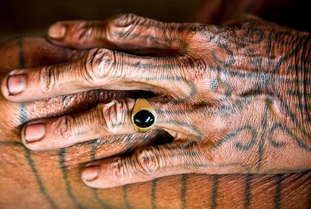 mentawai tribe, sumatra, indonesia. his fingers remind me of a knobby tree