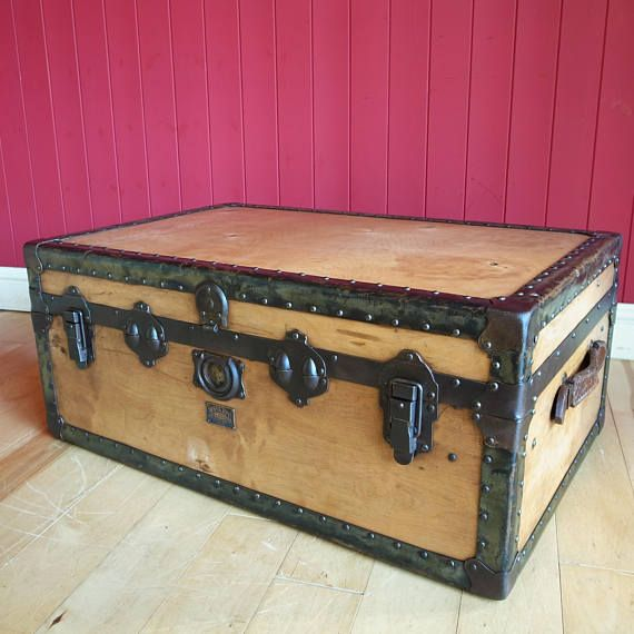A 1930s steamer trunk by Watajoy London in sturdy ply with studded fibreboard trim, steel reinforced corners, metal edged lid, original leather handles in steel keeps, 3 rear mounted butterfly hinges, 2 large industrial up and over clasps and interlocking catches. Featuring full