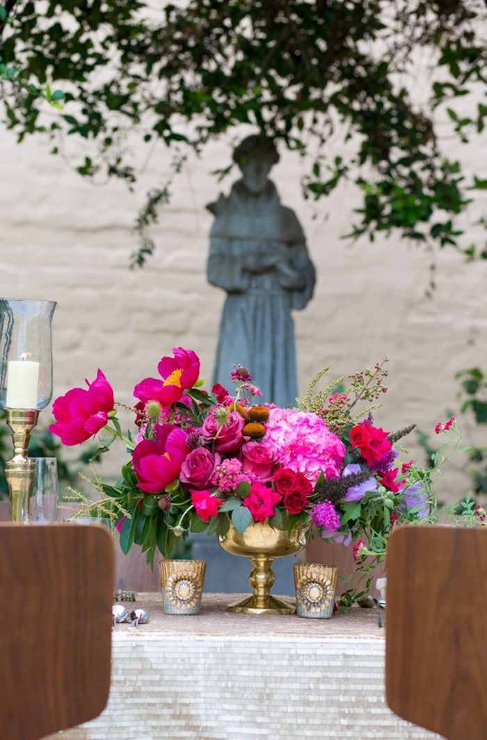 Gorgeous fuchsia floral centerpiece arranged in a brass pedestal bowl. #pink #wedding #flowers #centerpiece