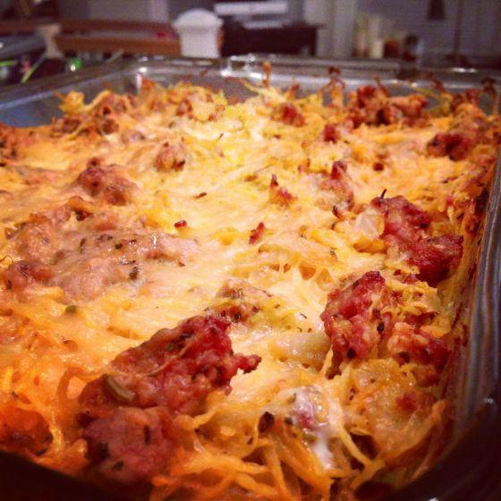 Paleo/Zone Spaghetti Pizza: 3 c spaghetti squash= 3C, 1 c tomato sauce = 1C, 1/2 c onion = 1C, 3 eggs = 3P, 13.5 oz sausage= 9P, Total= 6C, 12 P