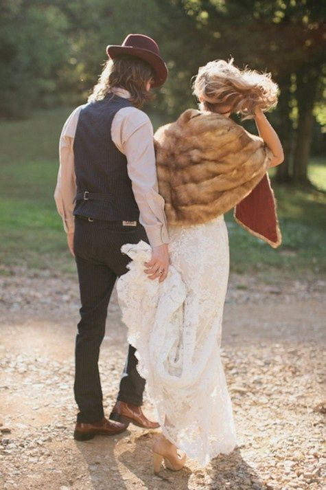 hipster wedding couple - bride with faux fur--  Good wedding pic. Like he is holding her dress bc they are so relaxed like that and love fur w long dress