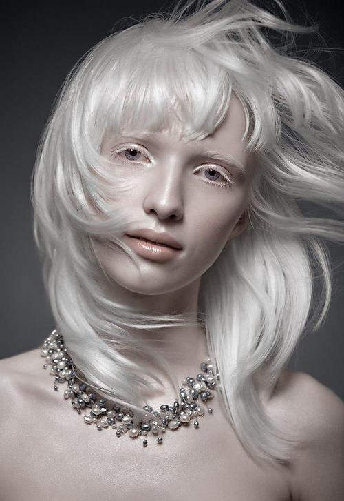 Albino fashion model Nastya Zhidkova. Her unique coloring and striking eyes make her ideal for futuristic and minimalist photographs. Her paleness evokes feelings of chilliness, making it a great compliment to technology.