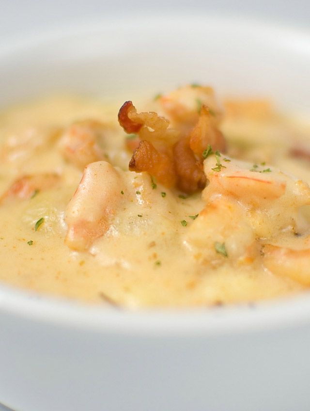 Recipe for Shrimp & Grits _ Cheesy grits topped with Shrimp & Bacon tossed in a Cajun cream sauce. I don't make a lot of Southern food. However, I have heard a lot about shrimp & grits. The people who talk about it talk as if they are describing the best meal they ever had!