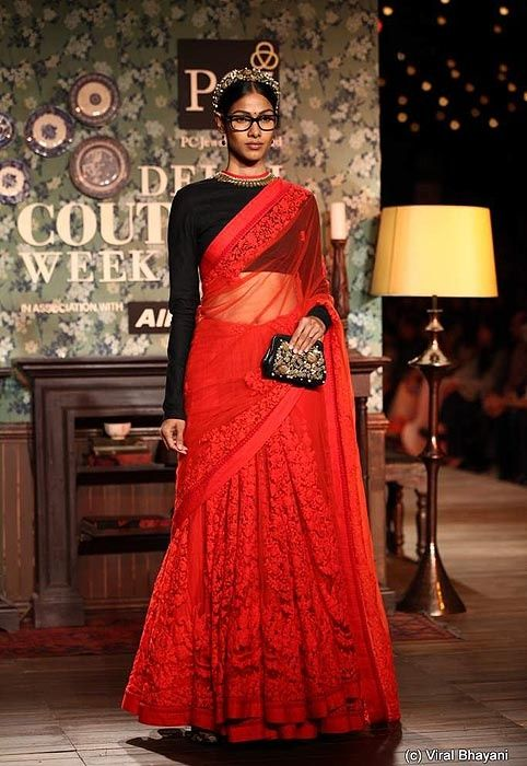 A lace and tulle Sabyasachi lehenga sari in a classic red. Available at all Sabyasachi stores in India